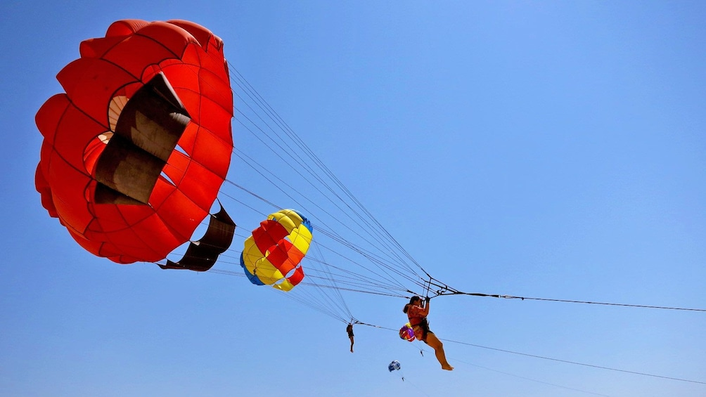 Show item 2 of 5. parasailing close to other parasailers in Bali