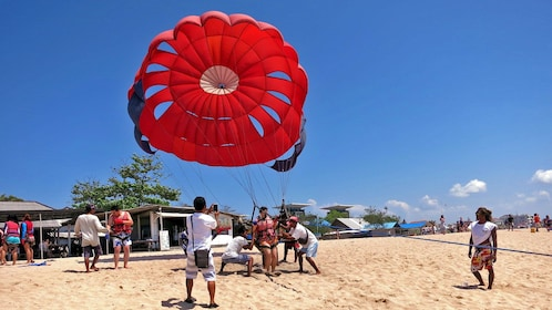 woman setting up to go parasailing in Bali