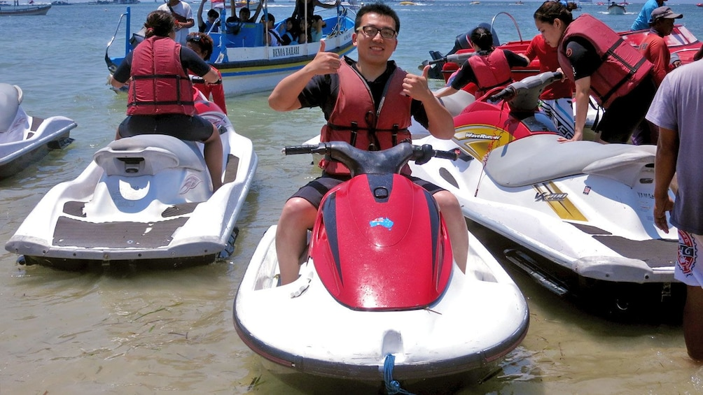 Show item 1 of 5. man on jetski at the beach in Bali