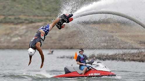 flyboarding man diving into the water in Bali