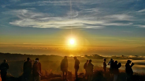 group on Mount Batur observing the sunrise in Indonesia