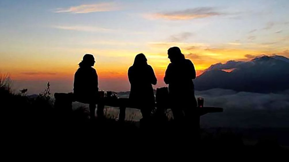 Tampilkan item 1 dari 5. bundled group viewing the sunset from Mount Batur in Indonesia