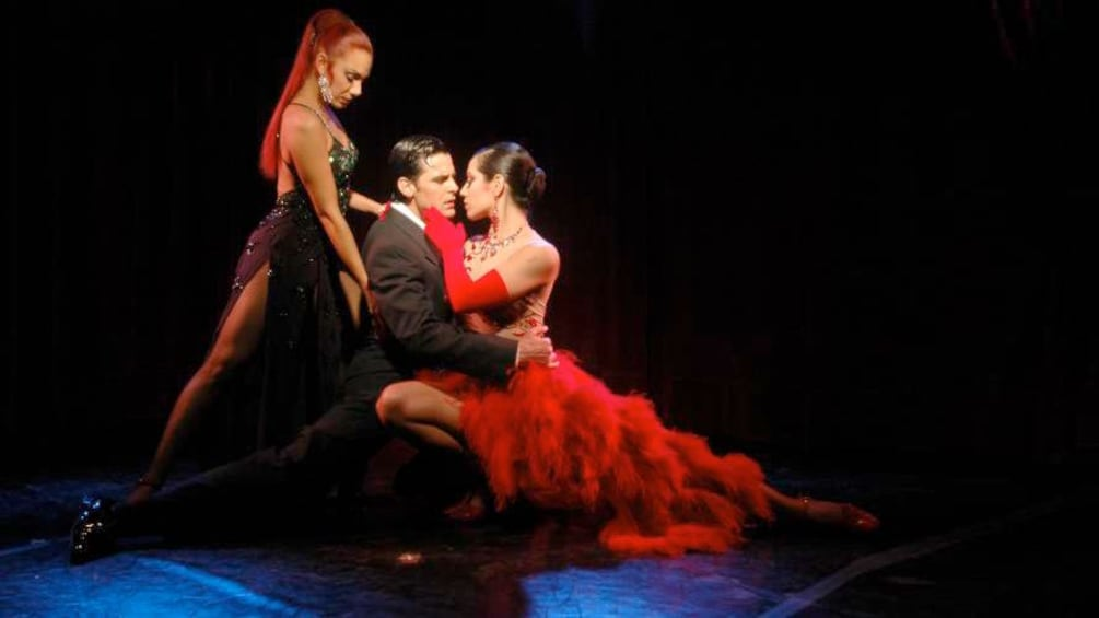 Cargar ítem 5 de 5. Couple and lady dancer performing at the dancers at the Rojo Tango Exclusive Dinner and Tango Show in  Buenos Aires
