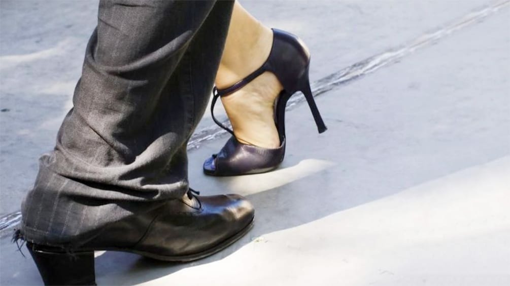 Close up of a couples' feet as they tango dance at the Tango Porteno Show in Buenos Aires