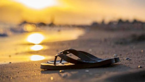 View of a pair of flip flops on the serene beaches in Joao Pessoa