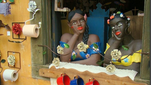Painted life-size statues in the window of a craft shop in Sao Paulo