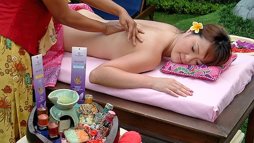 woman receiving a relaxing outdoors massage in Bali