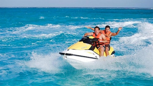 Tourists enjoying the high speed wave runner in Cancun