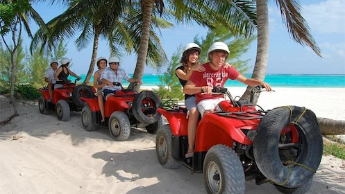 Tourists exploring the Mayan Riviera on our off-road ATVs in Cancun