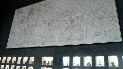 Mural and historic figurines on display at the Diego Rivera Anahuacalli Museum