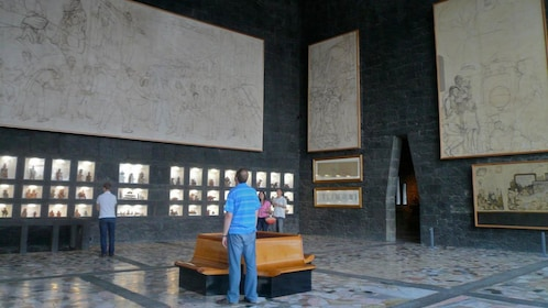 Tourists gaze in awe of the murals and historic artifacts within the Diego Rivera Anahuacalli Museum