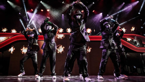 Jabbawockeez performing a dance routine onstage at the Luxor Hotel and Casino in Las Vegas