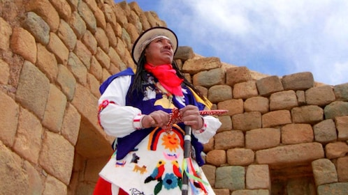 Man dressed in traditional Inca clothing at the ruins of Ingapirca near Cuenca