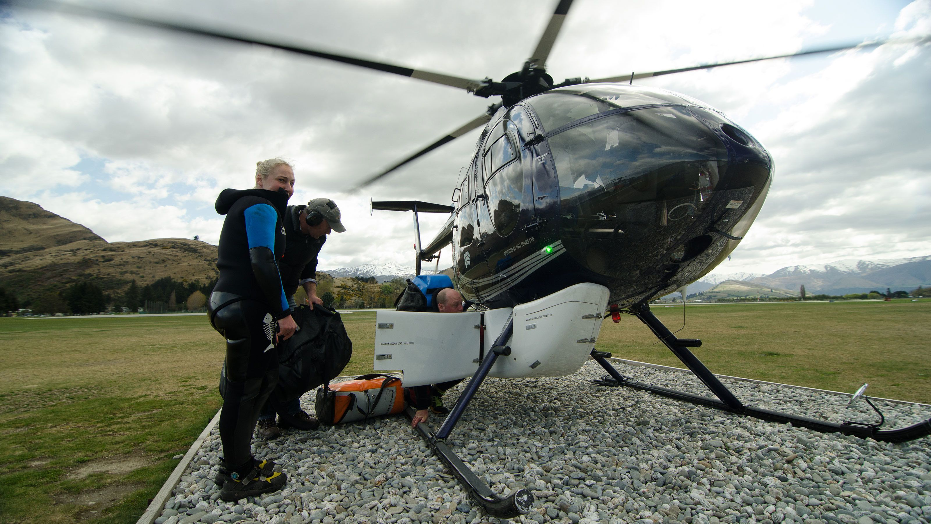 Adventures packing gear into helicopter in New Zealand
