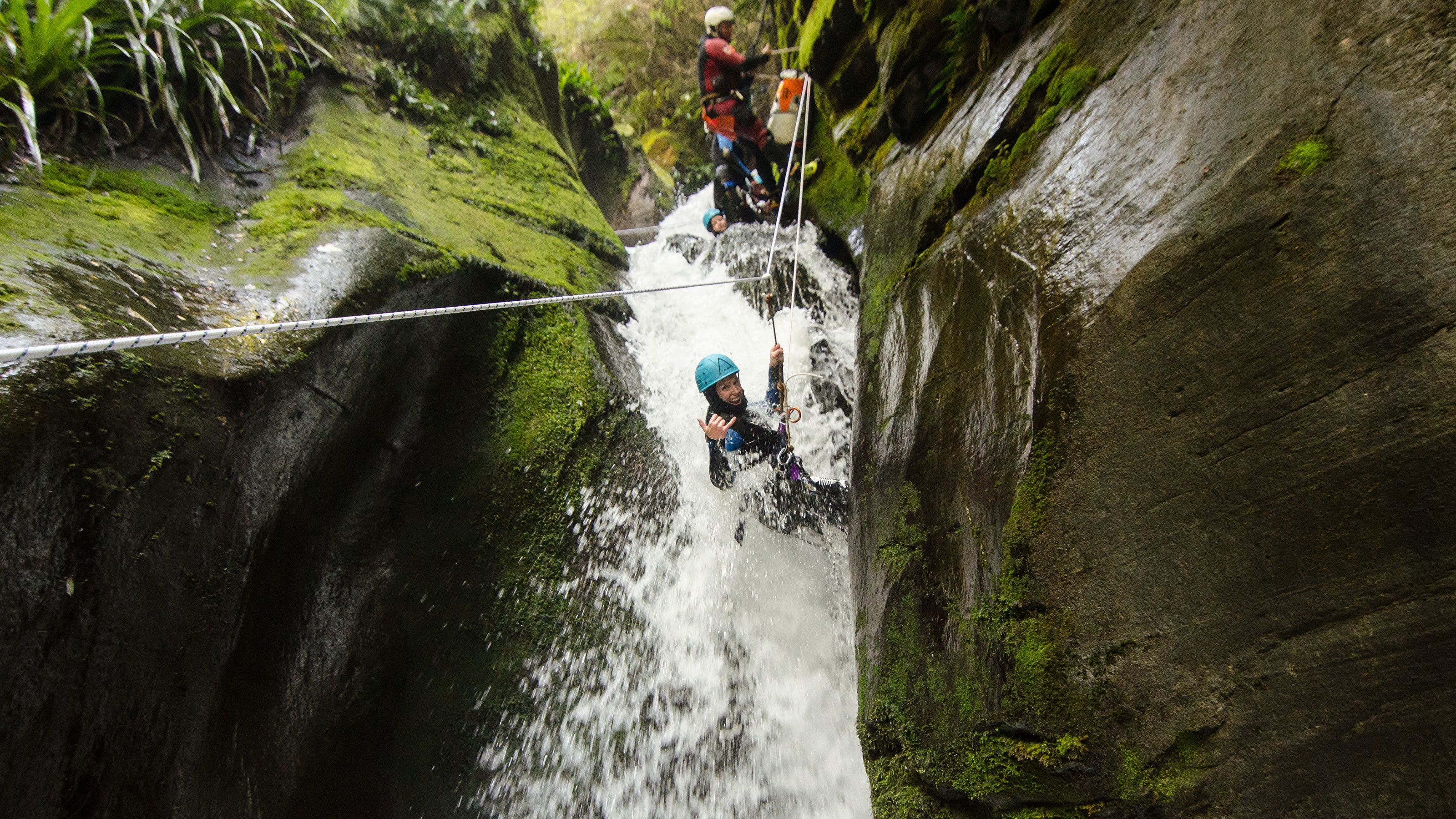 Canyoning in mossy waterway in new zealand