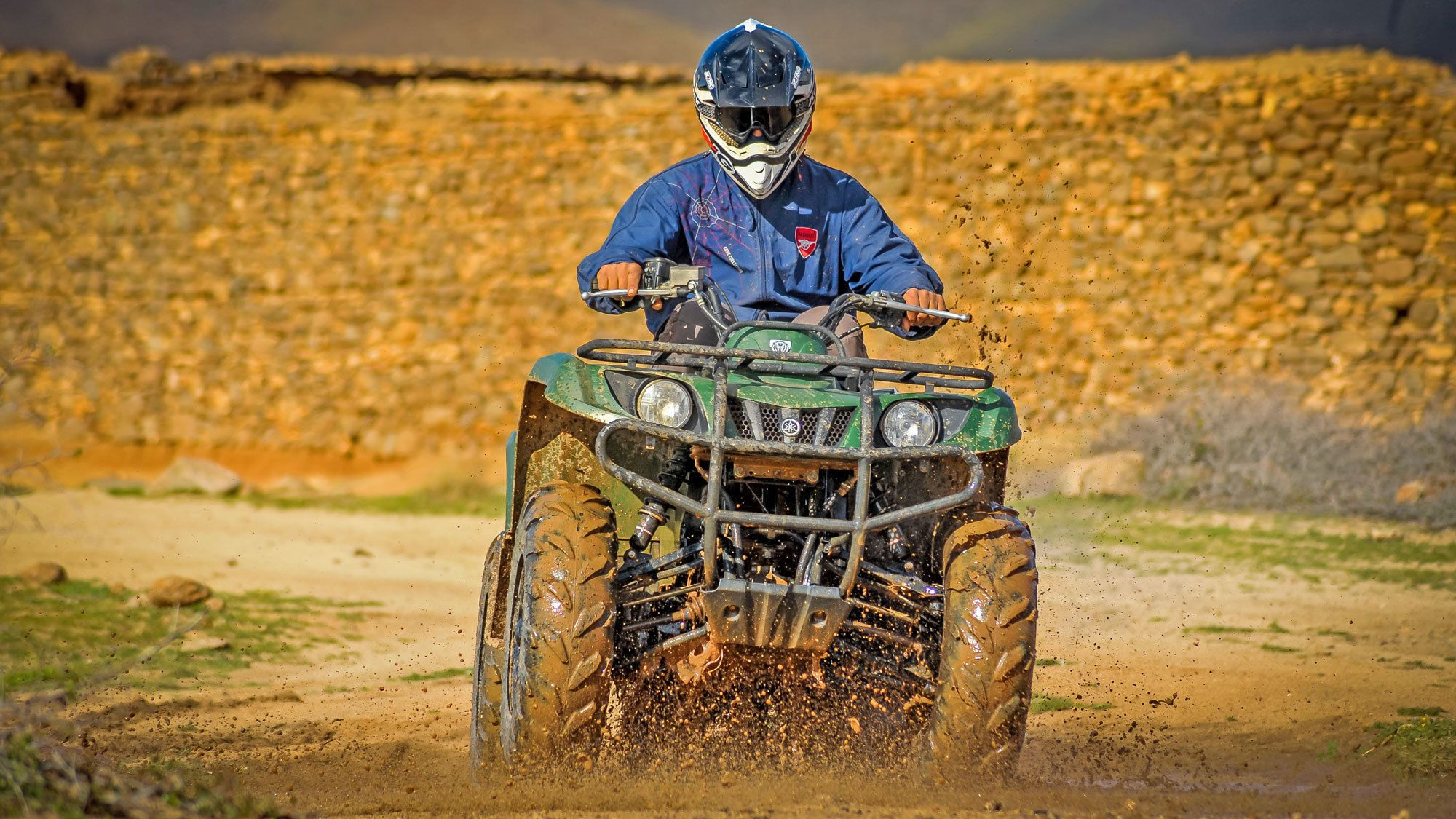 riding a quad bike through the muddy road in Morocco