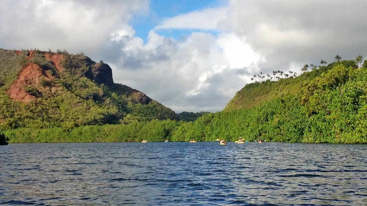 Kayakers in the distance in Kauai
