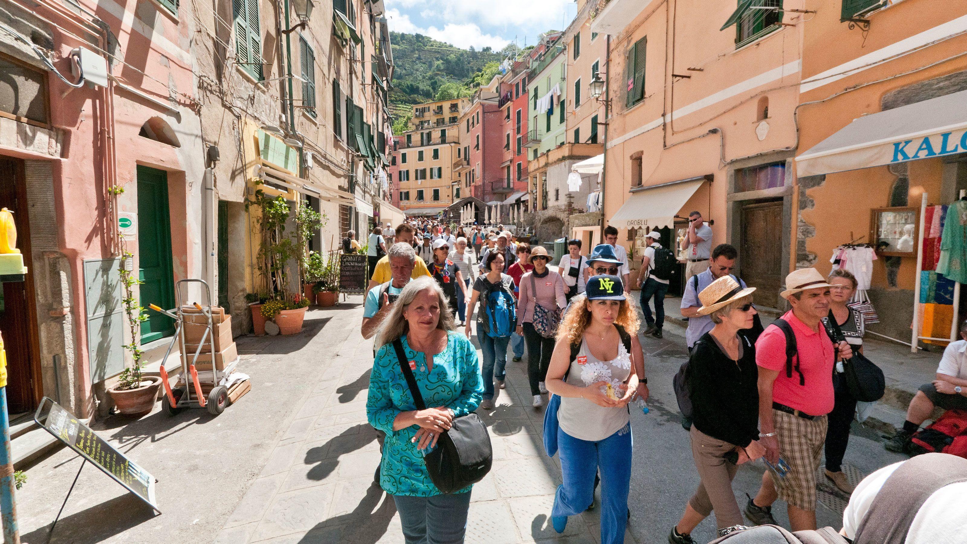 Italian pedestrians walk through city streets