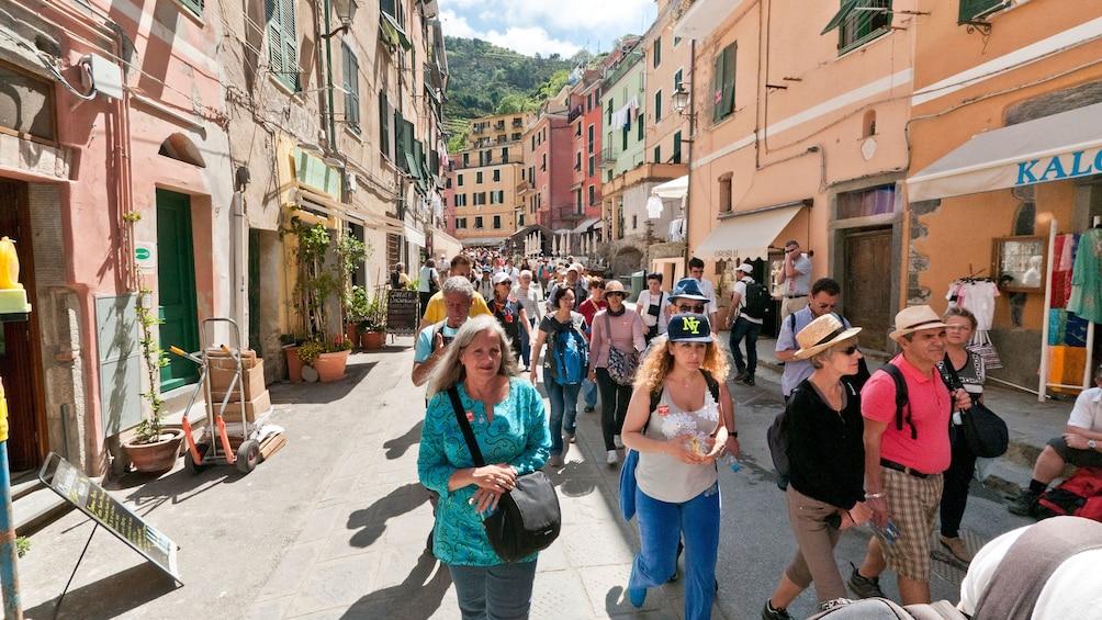 Show item 3 of 7. Italian pedestrians walk through city streets