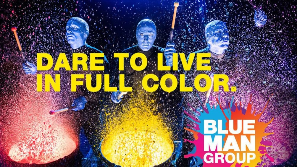 Show item 1 of 5. Blue Man Group banging on paint covered drums in New York