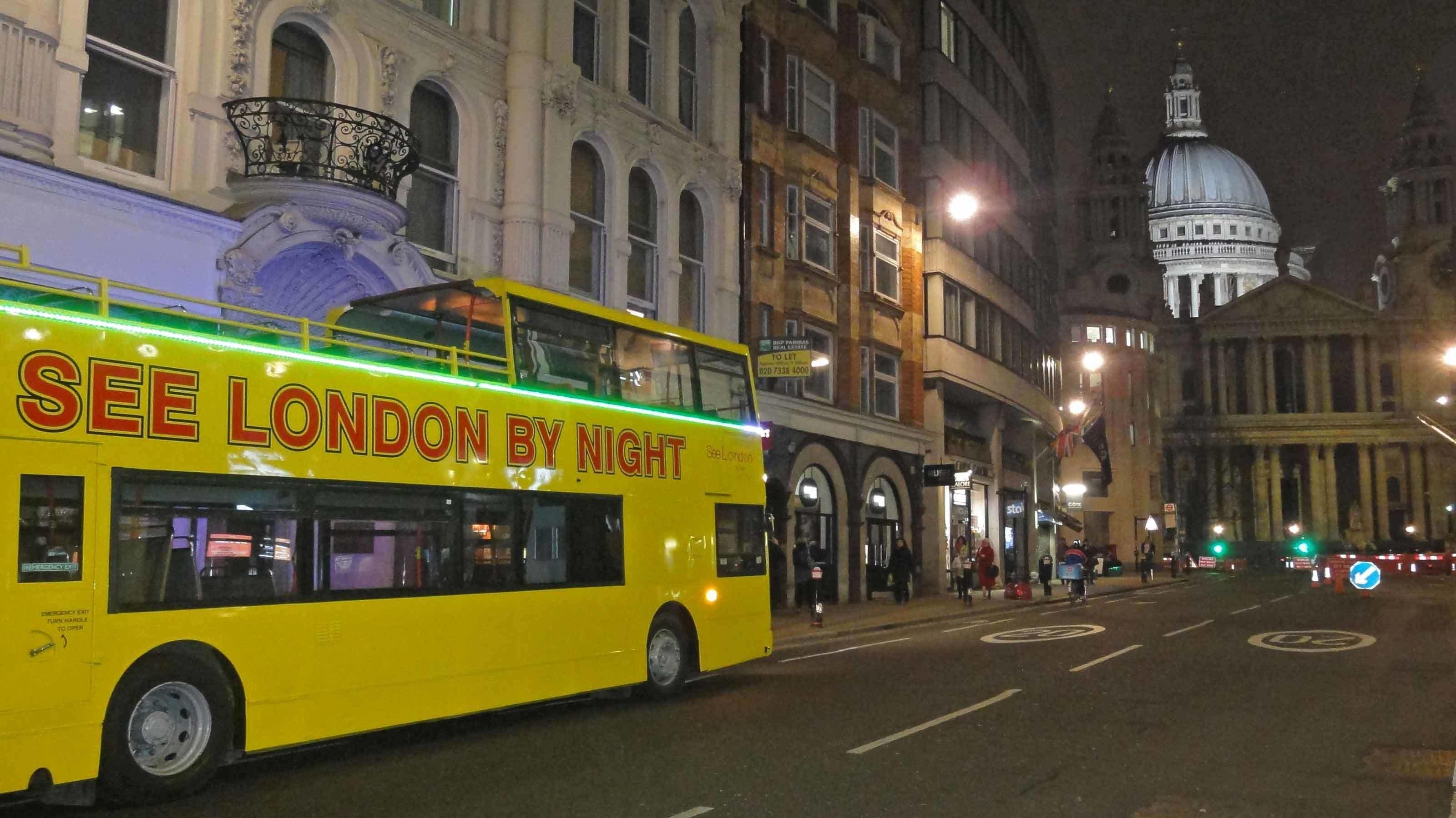 London by night tour bus on street