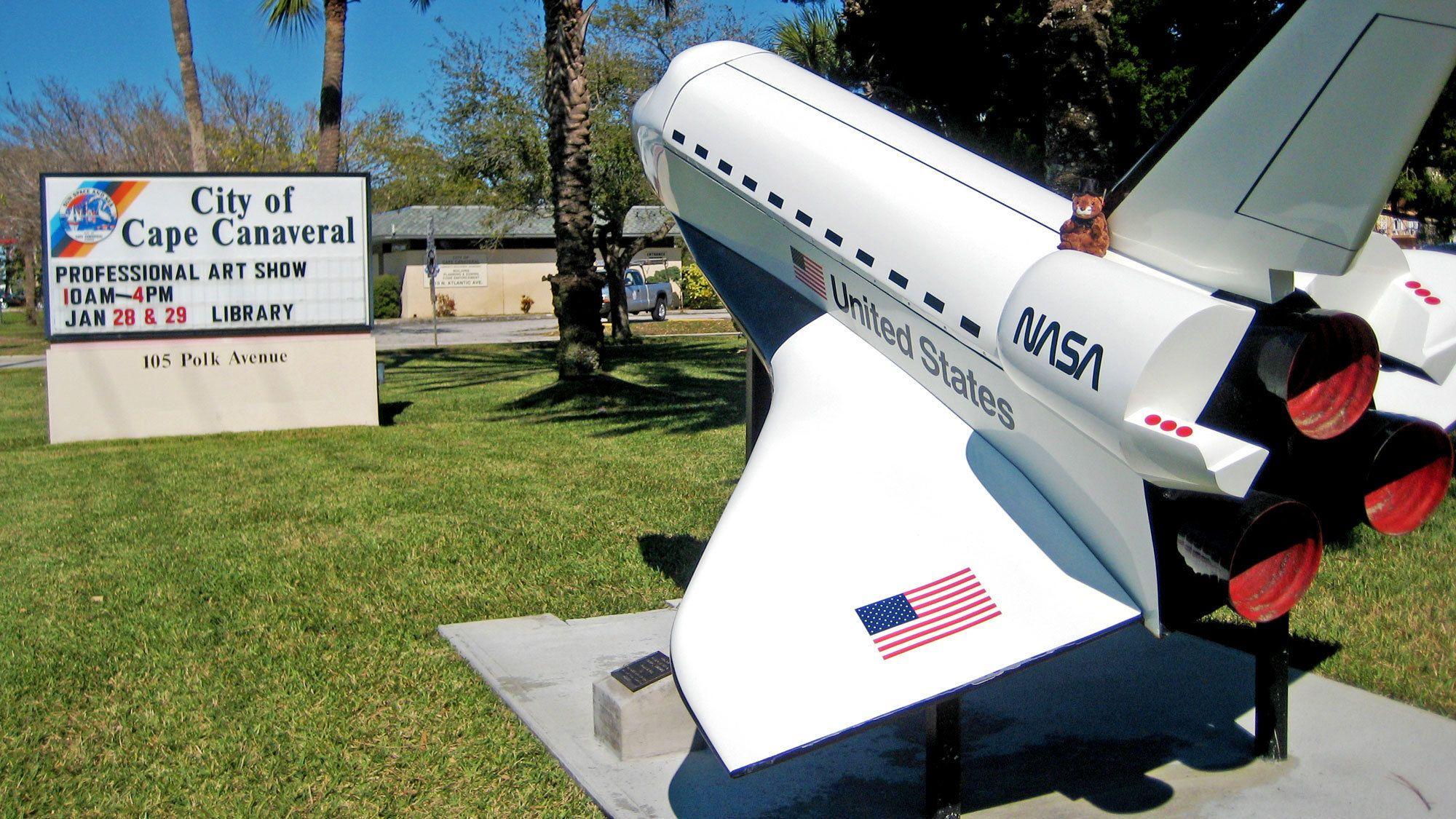 small shuttle model near a road sign in Miami