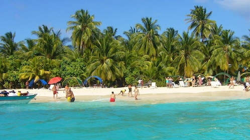 beachgoers enjoying the sunny weather in San Andres