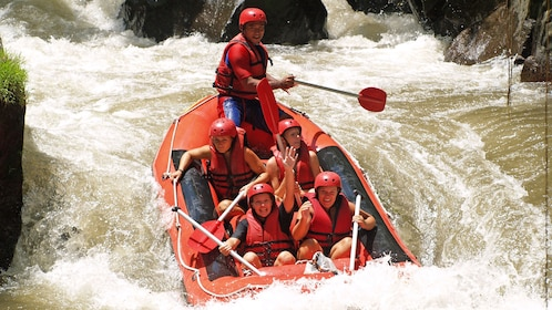 raft descending through the rapids in Bali