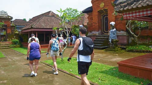 group walking through a small village in Bali