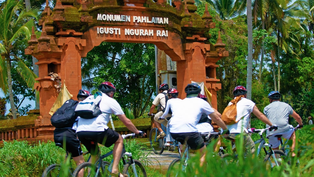 Show item 3 of 7. Bicycle group heading towards attraction in Bali