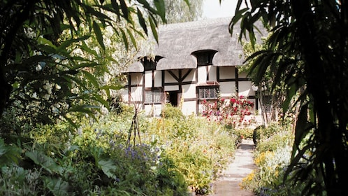 Cottage with surrounding gardens in England