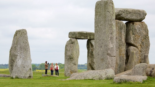 Group standing near the rocks at Stonehenge in England
