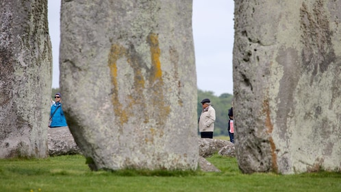 Looking through the rocks at visitors to Stonehenge in England