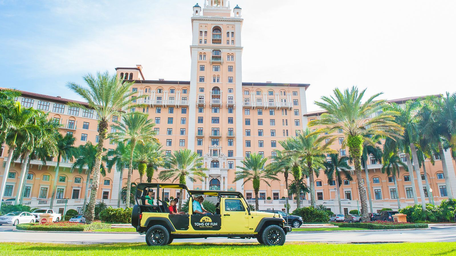 Open-aired Tons of Fun jeep parked in front of Miami City Hall