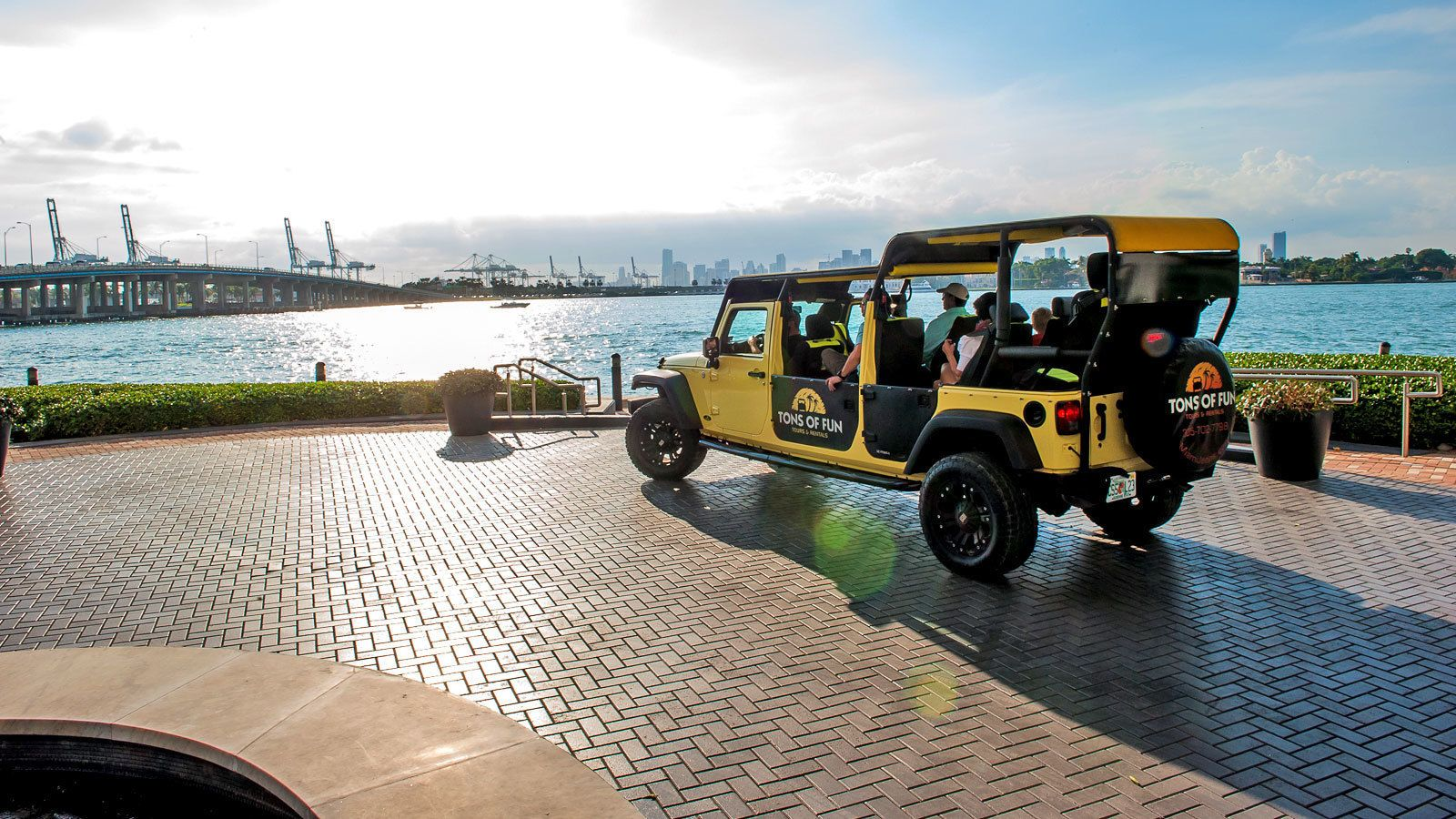 Open-aired Tons of Fun jeep parked near Biscayne Bay in Miami