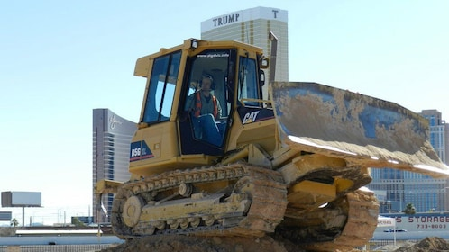 learning how to operate a small bulldozer in Las Vegas