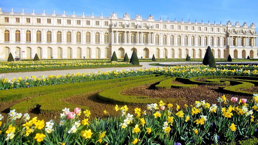 Show item 1 of 6. a flower garden outside of a palace in Versailles