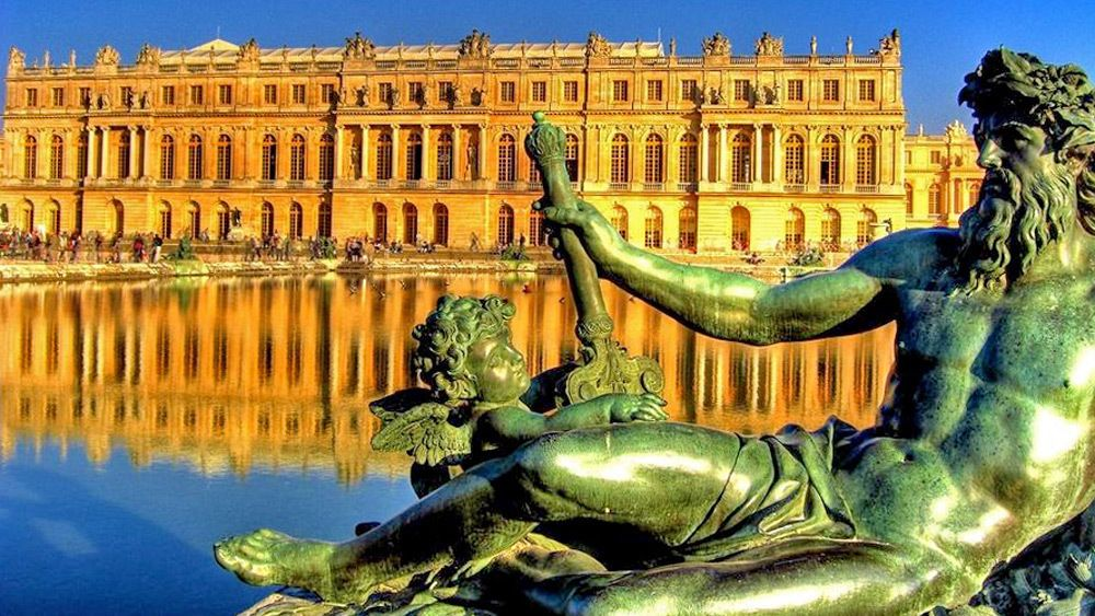 old statue outside the palace in Paris