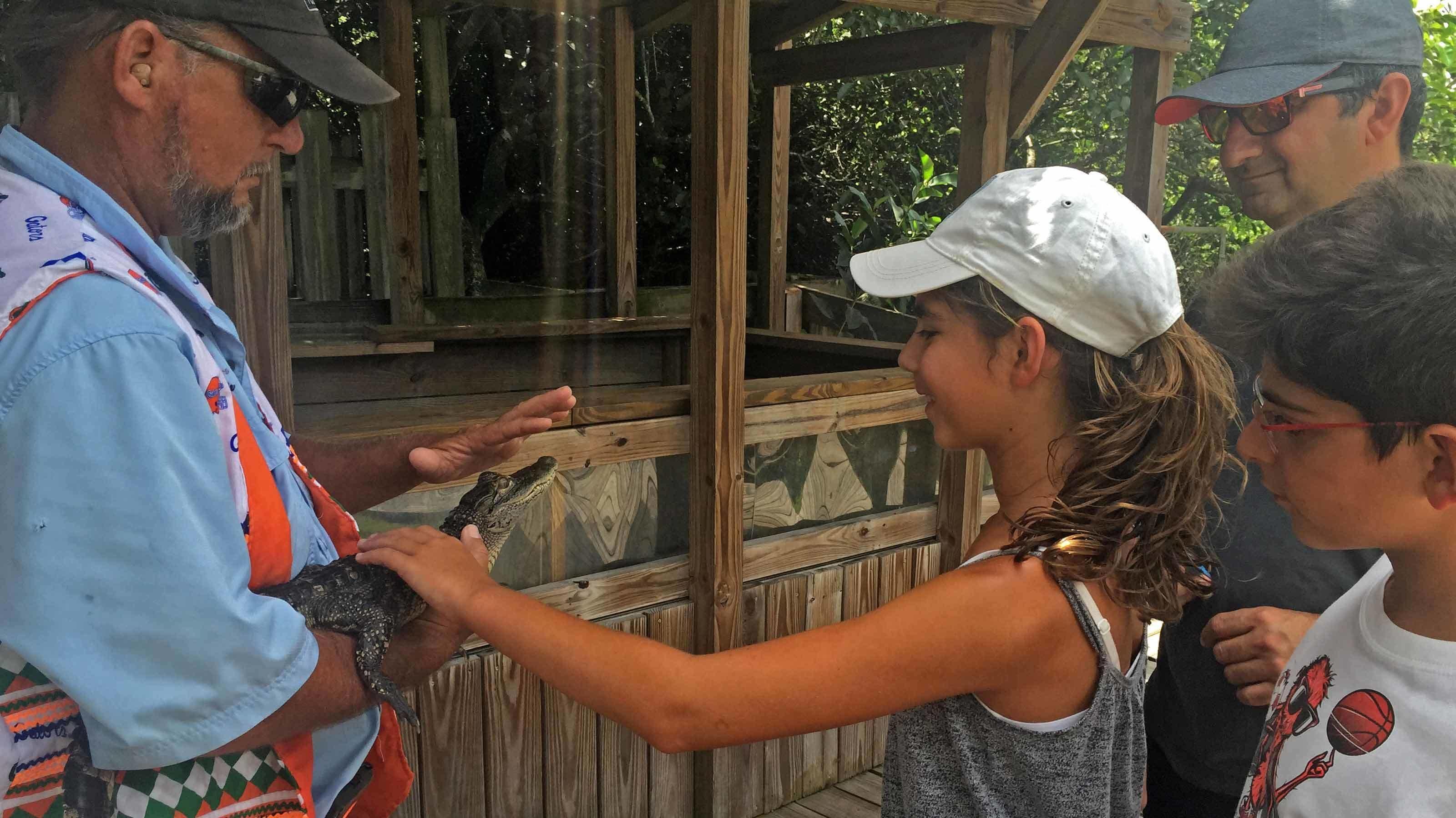 Girl petting small reptile in Florida