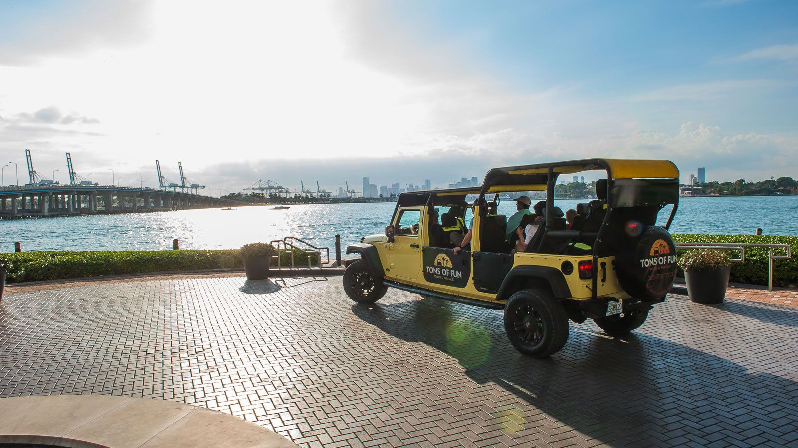 jeep vehicle with passengers parked near the water in Miami