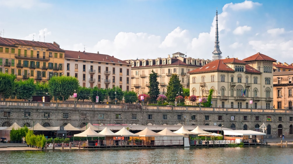 Show item 3 of 5. small pitched tents at the waterfront in Turin