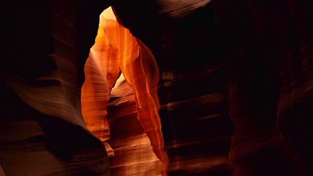Show item 4 of 5. Sunlight peeking through the cracks in Antelope Canyon in Arizona