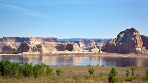 Lake Powell with cliffs and rock formations in the background in Arizona