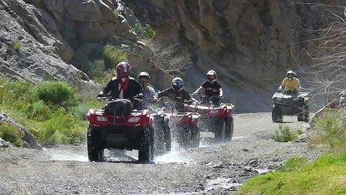 riding ATVs through water puddles in the desert in Las Vegas