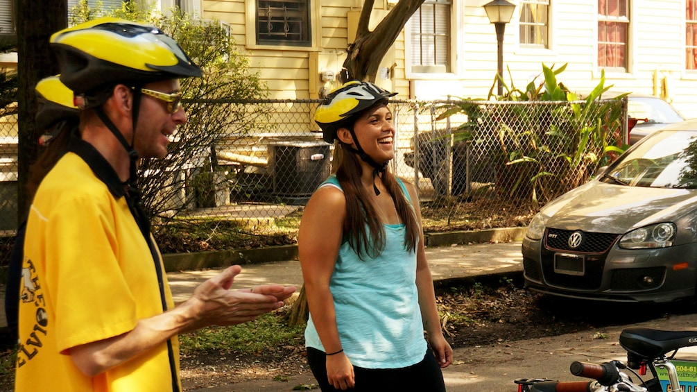 Show item 4 of 4. Bicycling pair in New Orleans