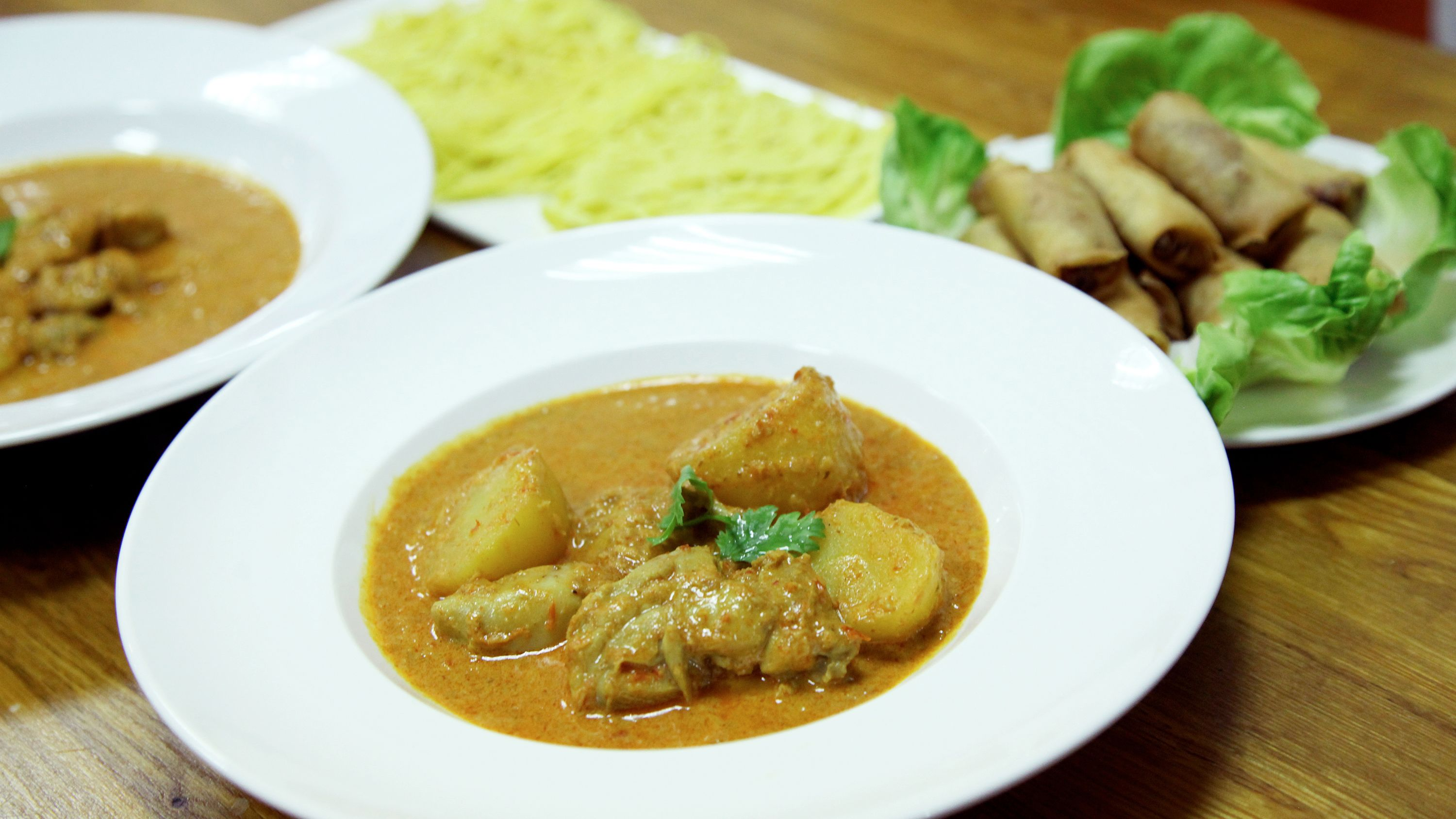 Close view of curry and egg rolls in Singapore