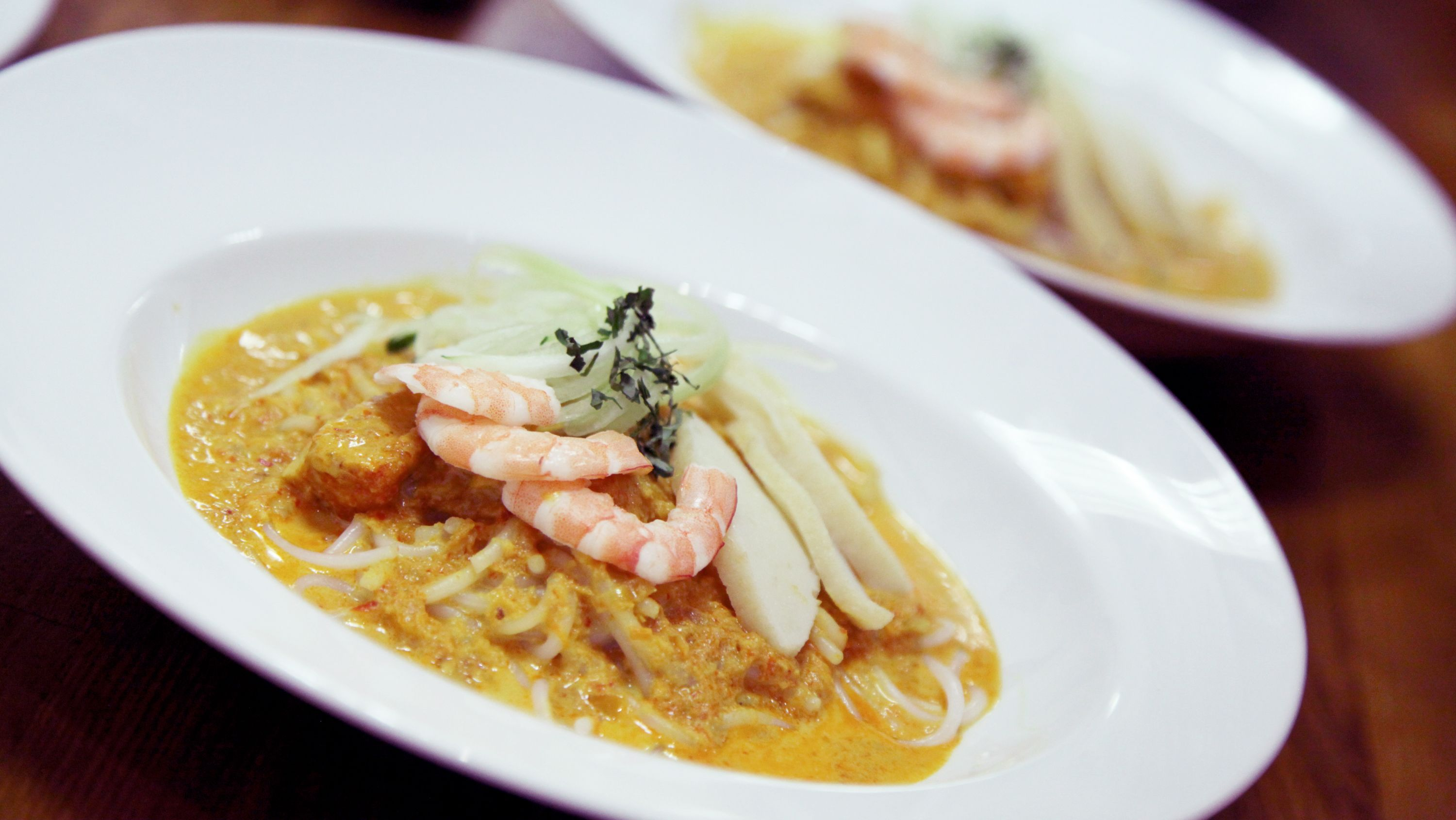 Two curry dishes made at the cooking class in Singapore