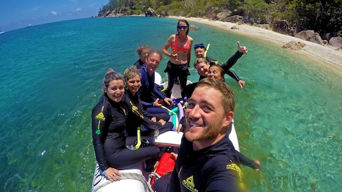 group wearing wet suits on a small raft in Australia