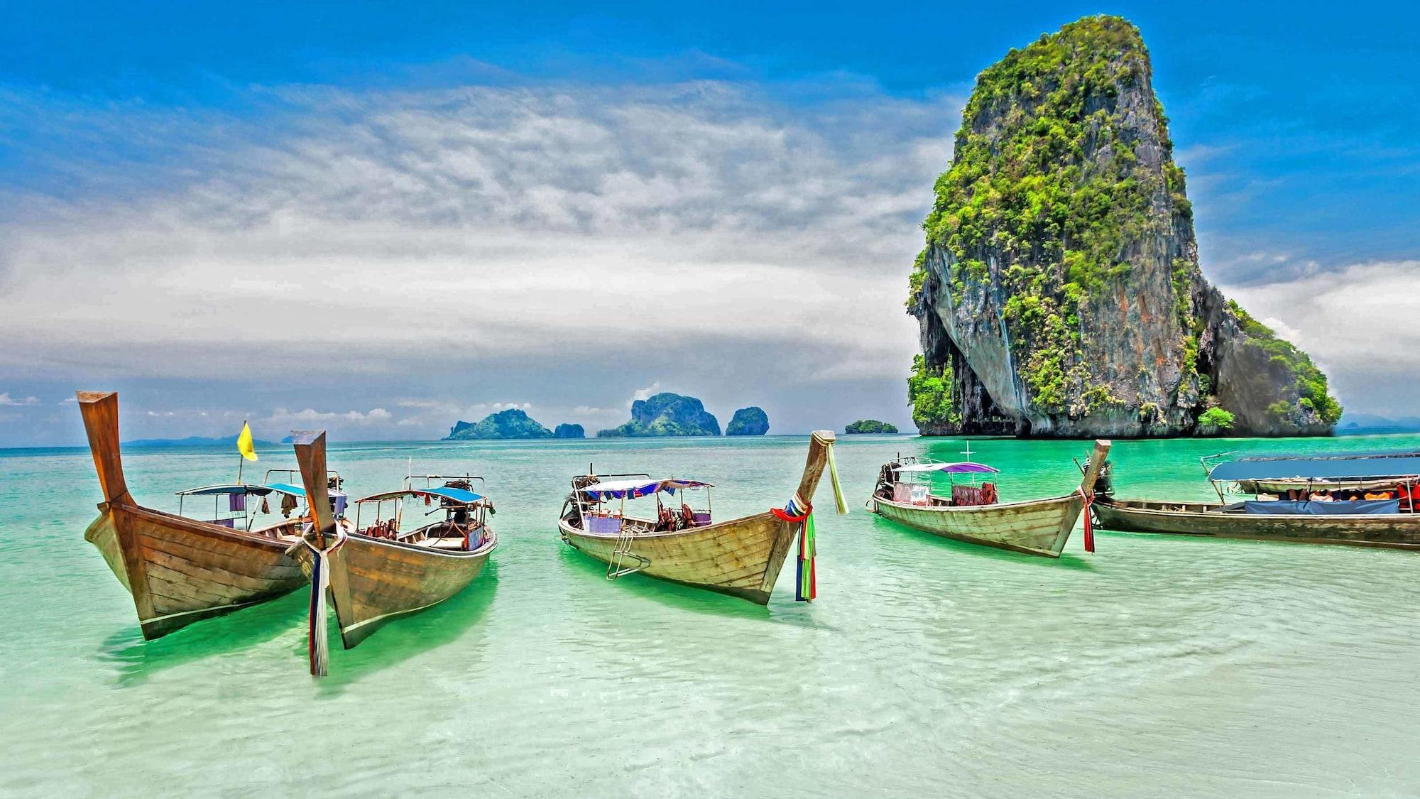 small boats anchored near shore