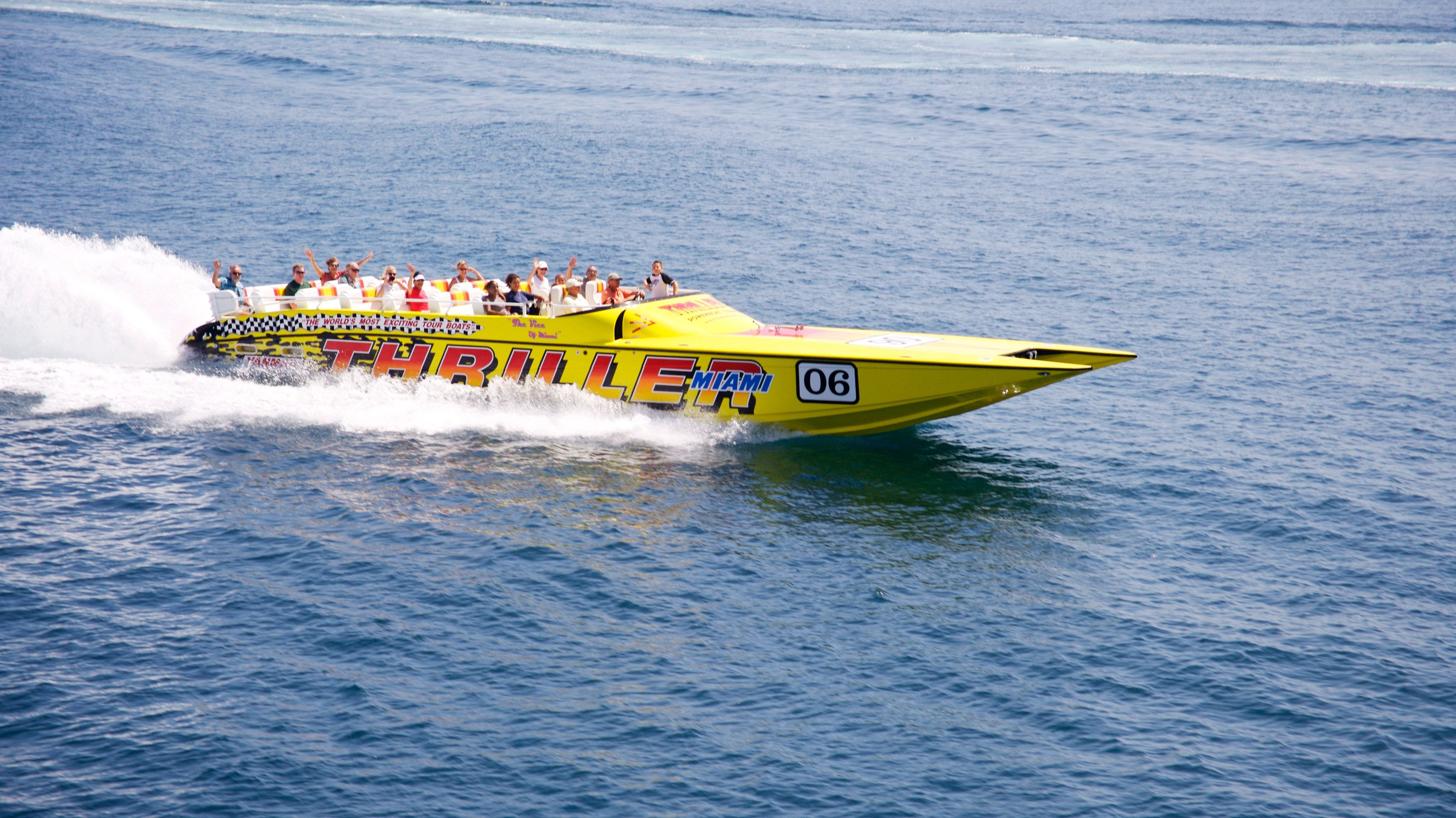 High angle shot of yellow Thriller speedboat cruising off the coast of Miami
